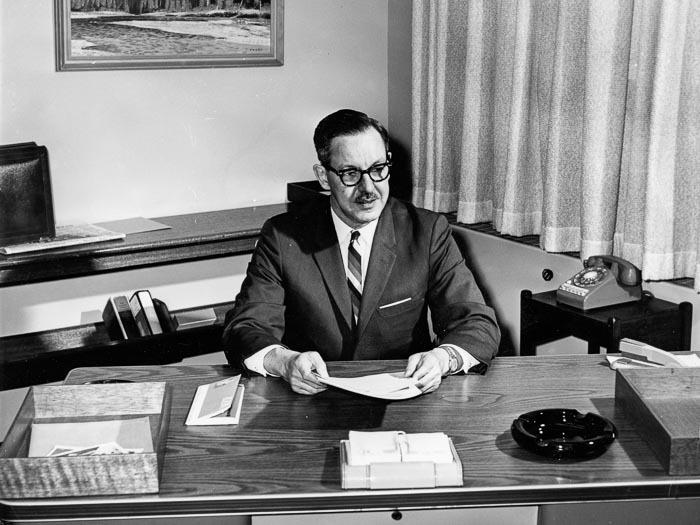 Judd Brehaut at his desk, Calgary Herald
